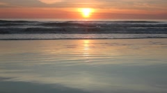 Golden Sunset reflecting on a Beach 2 min clip Stock Footage