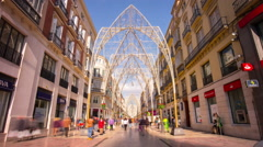 Spain malaga city sun light main street holiday decoration 4k time lapse Stock Footage