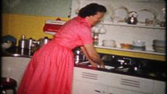 1950 - women washing dishes in the kitchen after party - vintage film home movie Stock Footage
