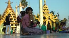 Girl prays at Schwedagon Pagoda,Yangon,Burma Stock Footage