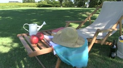 Deckchair and picnic set in a park Stock Footage