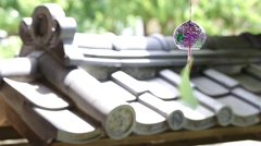 Wind chime fluttering in the wind in traditional Japanese house Stock Footage