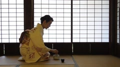 Mature Japanese woman in a kimono preparing green tea in a traditional house Stock Footage