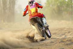 Motocross racer accelerating speed in track Stock Photos