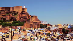 Mehrangarh Fort overing the old blue city, in Jodhpur, India Stock Footage