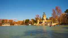 Buen retiro park pond boat riding sunny day view 4k time lapse madrid spain Stock Footage