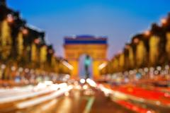 Arch of Triumph at night, Bokeh background Stock Photos