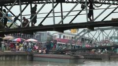 Bridges and loading of riverboats,Yangon,Burma Stock Footage
