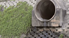 Water Running out of Storm Water Drain Pipe Stock Footage