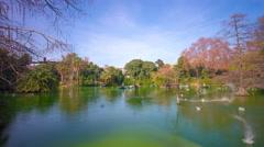 Spain barcelona ciutadella park sun light pond panorama 4k time lapse Stock Footage