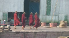 Monks on a alms round on the jetty,Yangon,Burma Stock Footage