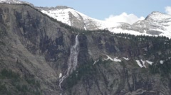 Waterfall on mountain in the distance - stock footage