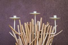 Wooden sculpture applied to be candlestick - stock photo