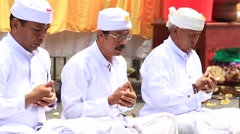 Men praying at holy temple during the religious ceremony. Ubud, Bali, Indonesia Stock Footage