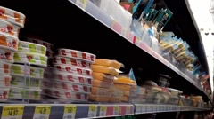 Man selecting cheese in grocery store Stock Footage