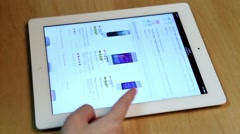 Woman shopping new cellphone of Futureshop website on ipad display Stock Footage