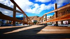 Stock Video Footage of 4K Wooden bridge at beach Playa de Santiago La Gomera Canary islands Spain