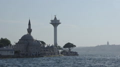 Radar navigation tower and mosque on windy weather, silhouette Stock Footage
