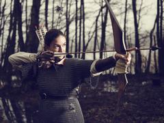 Medieval archery, woman shoot - stock photo