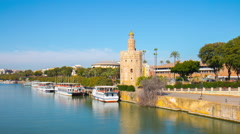 Sun light river panorama torre del oro seville sunny day 4k time lapse spain Stock Footage