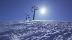 Snowstorm on top of a mountain with sun background-slow motion Stock Footage