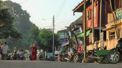 Young monks hammers bell on alms round,Katha,Burma Stock Footage