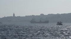 Small tanker crossing the Bosporus Edge, foggy, silhouette, Galata Tower Stock Footage
