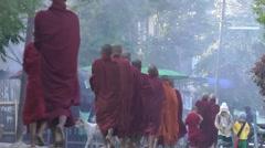 Monks collecting alms,Katha,Burma - stock footage