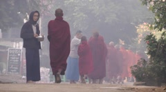 Monks collecting alms,Katha,Burma Stock Footage