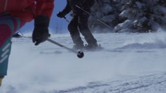 Black skier snow swirled in slow motion in closeup Stock Footage