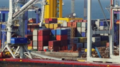 4K UHD. Container trucks delivers cargo from container terminal in port Stock Footage
