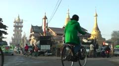 A temple with street traffic,Bhamo,Burma Stock Footage