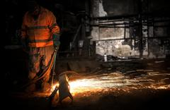 Stock Photo of Welding manwith sparks