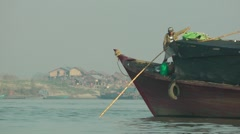 Pushing a river boat from the bank,Bhamo,Burma Stock Footage