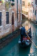 Venice canal with gondola, Italy - stock photo