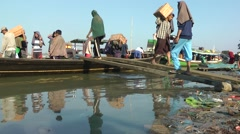 Unloading the riverboats,Bhamo,Burma Stock Footage