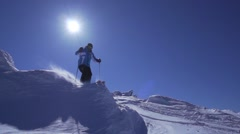 Professional skier jumps from the spectacular snow bump super slow motion Stock Footage