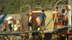 Closer look unloading riverfront,Bhamo,Burma Stock Footage