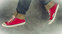 Loopable Stop Motion Animation of Young Person in Jeans and Red Sneakers Walking Stock Footage