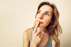 Portrait of Funny girl in doubt about something. Stock Photos