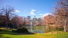 sunny day pond panoramic view on palacio de cristal 4k time lapse spain - stock footage