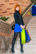 Young girl in the mall with shopping bags Stock Photos