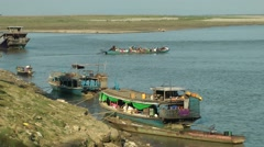 Small passenger ferry leaving Jetty,Katha,Burma Stock Footage