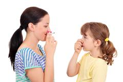 Smoking can cause asthma and diseases in children Stock Photos
