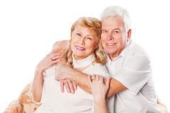 Happy senior couple in love. Isolated on white Stock Photos