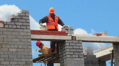 House builders erect Stock Footage