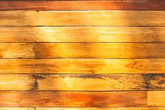 Stock Photo of Natural light on wood plank wall texture background
