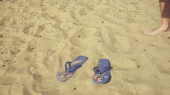 Man putting on Flip Flops at the beach - Hd video.mp4 Stock Footage