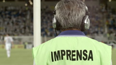 A member of the Brazilian press watches soccer. Stock Footage