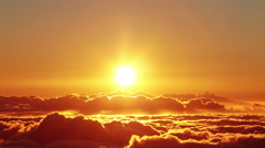 Beautiful sunset over clouds, time lapse Stock Footage